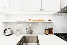 Check out the renovation of a true one-bedroom apartment in Manhattan's Chelsea neighborhood completed by a Sweeten general contractor. Small Sink, Apartment Renovation, Kitchen Cabinets, Kitchen Sinks, Maximize Space, One Bedroom Apartment, Beautiful Kitchens, Bathroom Medicine Cabinet, Chelsea