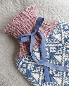 A beautiful hot water bottle cover in yarn. It starts with a provisional cast-on and is knitted in the round. The stitches at the lower edge are grafted together, and the rib cuff includes eyelets to thread with ribbon. Provisional Cast On, Water Bottle Covers, Knit In The Round, Circular Needles, Stitch Markers, Crochet Hooks, Stitches, Ribbon, It Cast