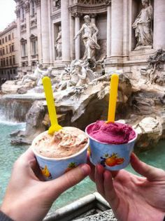 Roma. The best gelato shop is straight ahead from this person. To the left of the Trevi fountain. Wish I could get some right now.