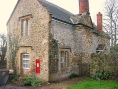 Cottage & red letter box in Kingstone, Somerset, England