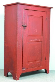 """PA Red Ochre Single Door Softwood Storage Cupboard, bead molded edges, two interior shelves, single double raised paneled door, bracket feet, Ex. Marilyn Kowolski est., 59""""h. x 40""""w. x 19-½""""d., (old repairs, natural wear to original painted surface)."""