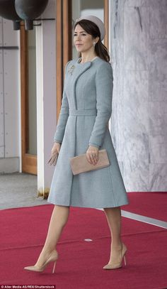 Crown Princess Mary wore nude scaled heels with a light blue knee-length coat and pale pin...