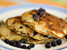 Blueberry Banana Pancakes - Made these for breakfast this morning - so good!  Tastes like banana bread with blueberries. :)  We didn't have the lemon and honey in the house; I omitted them and they came out just fine.