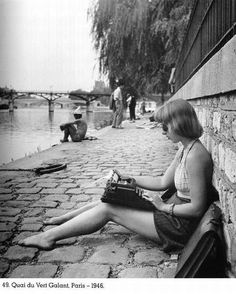 France. Writing a message with her period smart-typewriter... Quai du Vert Galant, Paris, 1946 photo by Robert Doisneau