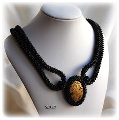 Necklace (probably right-angle weave) with cabochon by Peterne Szikati.