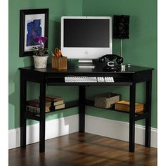 @Overstock.com - Black Corner Desk - Maximize your living space with this space-saving corner desk. Measuring 50 x 33.75, this desk sports clean lines and a black finish for a modern look. A pull-out tray will hold your keyboard, while a fixed lower shelf provides plenty of storage.   http://www.overstock.com/Home-Garden/Black-Corner-Desk/2404000/product.html?CID=214117 $156.99