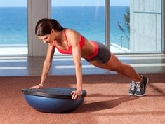 2. BOSU Ball Stability Planks (Black Side Up)  Flip a BOSU ball so that the hard side faces upwards. This also works with a balance board. Assume plank position with your forearms at shoulder width on top of the BOSU ball. Gently tilt your body and roll from side to side. Hold for 45 seconds.  Up the difficulty, up your growth: Stack your feet on top of each other.