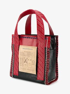 Balenciaga | Scaffold Tote Bag - This black and red leather 'Scaffold' tote bag is so brilliantly complex, it comes with instructions. A head-turning piece!