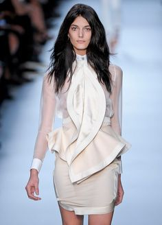 Peplum. Peplum silhouette can be employed through jackets, elaborate blouses, belts, and, more obviously, skirts/onepieces