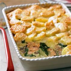 Salmon and potato bake recipe 1kg floury potatoes 1 tbsp olive oil 1 large red onion 1 tbsp plain flour 3 salmon fillets 200ml double cream 50g grated Gruyère A few handfuls of baby spinach