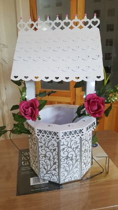 Made by Kerrie Versfeld - I made a wishing well using the scan n cut along with the craftorium usb and added flowers and lights.