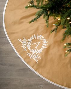 Monogram Initial Christmas Tree Skirt would be perfect with our cream/white/light green formal (living room) tree.