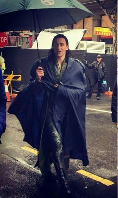 Awww dont get loki wet it will ruin his hair.