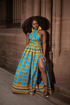 "African print infinity dress  Can be worn more than 10 different ways  2 side pockets Elastic Back  100% cotton  Made with high quality  African print wax fabric Can be worn with or without the slit Skirt measures approximately 45 inches  MODEL IS 5'6 B- 34"" W- 28"" H- 37"" Wearing size REG (S-L)"