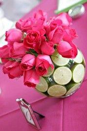 Cut limes and fuscia roses.