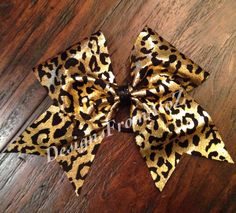 Black and Gold Cheetah Print Cheer Bow by DesignsFromAtoZ on Etsy https://www.etsy.com/listing/189396153/black-and-gold-cheetah-print-cheer-bow