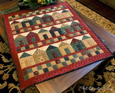 """""""Full House"""" quilt made with Icicle Kisses fabric line from Kansas Troubles - photo from Fat Quarter Shop's Jolly Jabber    ...quilt pattern no longer available..."""