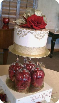 I love the flowers in the wine glass, holding the mini cake up! this would be perfect since I want a mini cake and cupcakes around it. and I'm obsessed with lavender so I would fill the glass with those instead of roses.