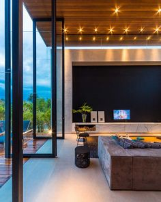 Double Height Doors // Modern Brazilian House in Londrina by Spagnuolo Arquitetura 7