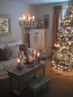 Shabby, vintage Christmas, love the coffee table and stool, and the chandelier hanging over them! Christmas Tree Themes, Noel Christmas, Merry Little Christmas, All Things Christmas, Winter Christmas, Christmas Crafts, Christmas Feeling, Christmas Lights, French Christmas