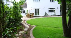 The design introduced interest to what otherwise could have been a large uninteresting expanse of grass by incorporating large interlocking . Brick Landscape Edging, Interlocking Bricks, Brick Path, Yard Design, Back Gardens, Circle Design, Dream Garden, Garden Inspiration, Garden Landscaping