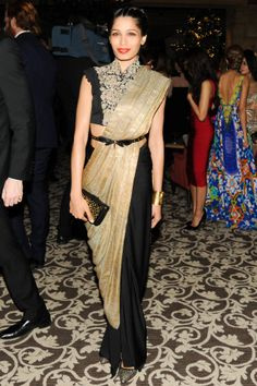 Frieda Pinto.. Love what she did with her sari! Very interesting