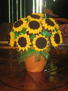 Sunflower Cupcake Bouquet! Chocolate cupcakes, oreo cookie center, vanilla petals.