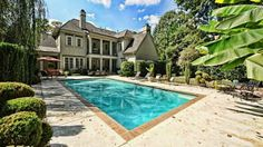 Check out this beautiful French Provincial Myers Park mansion that boasts 4 bedrooms, 5 1/2 baths, a custom-built kitchen and a master suite that looks out over the lush, private backyard.