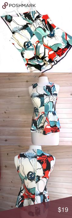 Anthropologie peplum top Anthropologie peplum top. Poly/spandex blend. Machine wash cold. Zip back. Worn once - like new! Anthropologie Tops Tank Tops