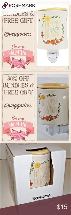 """💞30% off bundles💞 ✨BRAND NEW IN BOX✨ ONLY ONE LEFT!! NOT Scentsy but just as cute!!! Give the perfect housewarming gift with this SONOMA """" HAPPINESS IS HOMEMADE"""" wax melt. PRODUCT FEATURES Pretty design pops against your decor. SONOMA SCENTED WAX CUBE OUTLET WARMER WAX MELT WARMER. WHAT'S INCLUDED One ceramic electric wall plugin warmer One 15 watt lightbulb. Ceramic Wipe clean. Limited time get 30% off on all bundles... see my closet! Also receive 1 FREE WAX MELT CASE with each order…"""