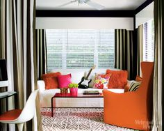 love the wood cornice and the striped curtains together.