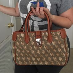PRICE DROP ⬇️⬇️⬇️ Dooney and Bourke NWOT ⬇️ Price Drop ⬇️ Dooney and Bourke Tote👜 Absolutely Stunning Purse ✨Brand New✨NeverWorn (NWOT)✨ This is an authentic Dooney & Bourke purse that has been sitting in my closet for a couple of years, in other words, has zero imperfections, no pen marks, no stains. 👜 NEW DOONEY & BOURKE 🚫 No Trades 🚫 PP and please no lowballing! Bags Totes