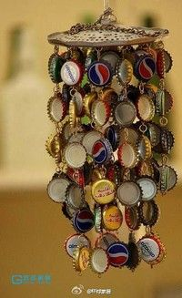 Ghetto windchimes now I know what to do with the bottle caps!