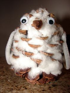Snowy owl. Owl made out of a pinecone and cotton balls. Also use a pine cone to make a bird feeder. Roll cone in egg whites then sprinkle with seeds. when dry, tie ribbon at top to hang. L.O.V.E.