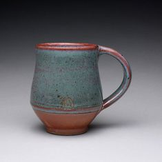 handmade ceramic mug, teacup, pottery cup with orange shino and green wood ash glazes   ray morales.