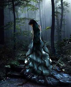 Fantasy image of a black-haired woman wearing a long green and blue dress on stone stairs in a misty forest. Dark Gothic, Gothic Art, Gothic Girls, Dark Fantasy, Fantasy World, Fantasy Pictures, Fantasy Images, Fairy Pictures, Fantasy Kunst