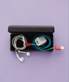 To avoid messy tangles with your various wires, roll them up tightly and throw them in a sunglasses case, which is easy to open/close and won't allow them to move around on the go. You can also do the same with jewelry. Click through for more packing tips to help you pack for your next summer vacation.