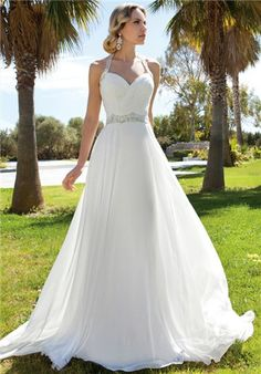 Chiffon, A-line halter gown with a Sweetheart neckline and ruched bodice. Waist and halter straps are embellished with jeweled beading. Skirt features a Chapel train.