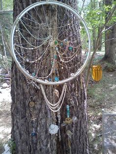 Looks like a dream catcher 2 me. re-purposed bike wheel - interesting piece inside or out