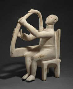 Seated harp player, ca. 2800–2700 b.c.; Early Cycladic I–II  Cycladic; Grotta-Pelos culture  Marble