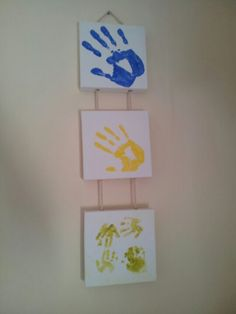 Hand print family keepsake - Colour mixing  blue (daddy) + yellow (mummy) = green (baby). Could do this for the hallway between kids rooms