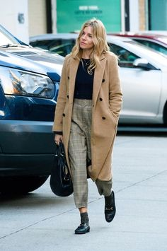 Le Fashion Blog Sienna Miller Black Sweater Tan Trench Coat Plaid Cropped Pants Black Loafers Via Vogue