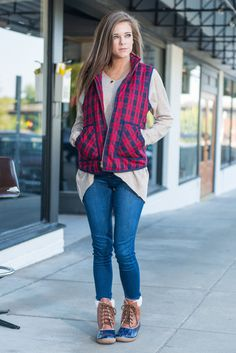 Everyone here at The Mint is so in love with this vest! It's so outdoorsy chic! The red and navy plaid is so trendy and we love that it has pockets! This cotton blend vest will definitely keep you warm and toasty on any hike!  Material has no amount of stretch. Miranda is wearing the small.