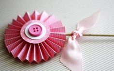 Accordion Folded Paper Flower Decorations ~    Crafting paper flowers is easy and make for a lovely addition to the decor of any celebration.    How To @  http://www.celebrations.com/content/accordion-folded-paper-flower-decorations