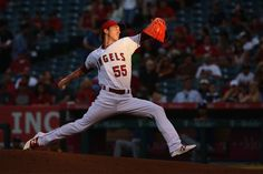 Tim Lincecum Photos - Tim Lincecum #55 of the Los Angeles Angels of Anaheim pitches during the first  inning of a baseball game against the Texas Rangers at Angel Stadium of Anaheim on July 19, 2016 in Anaheim, California. - Texas Rangers v Los Angeles Angels of Anaheim