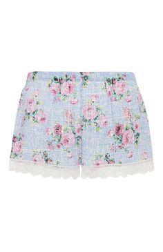 Primark - Blaue Shorts mit Spitzenbesatz und Blumendruck