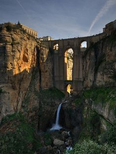 The Puente Nuevo is the newest and largest of three bridges that span the 120-metre (390 ft)-deep chasm that carries the Guadalevín River and divides the city of Ronda, in southern Spain. The architect was José Martin de Aldehuela, who died in Málaga in 1802. The chief builder was Juan Antonio Díaz Machuca.