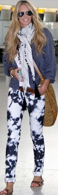 Who made Elle Macpherson's aviator sunglasses, scarf, and tie dye jeans that she wore in London?