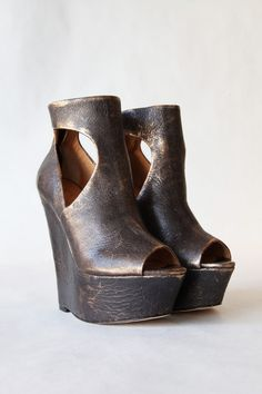 """These distressed, metallic-leather wedge booties feature an open toe and cutout sides. Hidden back zip. Covered platform and wedge heel. Leather sole.  * Heel: 5.75"""" (145 mm). * Platform: 2"""" (50 mm). * Leather: Cow. * Imported. * This item cannot be gift-boxed."""