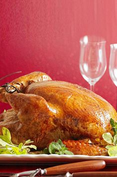 Sweet and tangy mingle in a gorgeous turkey that's brined for incredible flavor. #christmasmenu #christmasdinner #holidayfoods #christmasmenuideas #holidayrecipes #bhg